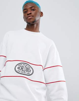 Asos (エイソス) - Asos Design ASOS DESIGN oversized sweatshirt with worldwide embroidery and piping