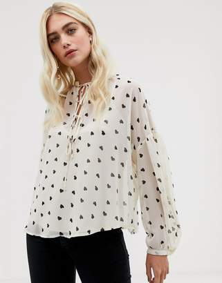 Asos Design DESIGN long sleeve oversized top with tie neck in Heart print