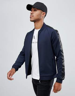0272f2df5e9 at ASOS · Armani Exchange zip-thru track jacket with taped sleeves in navy