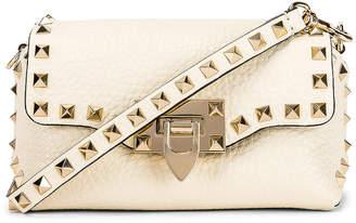 Valentino Rockstud Crossbody Bag in Light Ivory | FWRD
