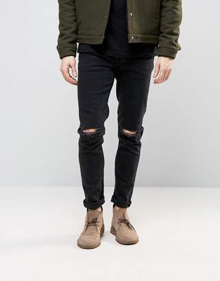 Asos DESIGN skinny 'Fletcher' jeans with knee rips in 12.5oz true black