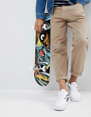 Asos DESIGN Skater Fit Jeans In Sand With Contrast Stitching