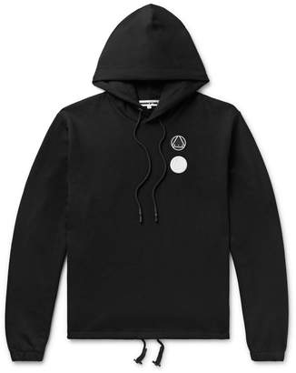 McQ Logo-Appliqued Printed Loopback Cotton-Jersey Hoodie - Men - Black