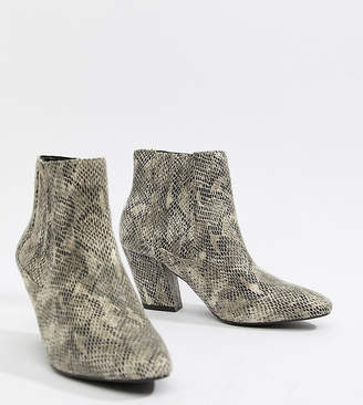 Asos DESIGN Reminisce chelsea ankle boots in snake print