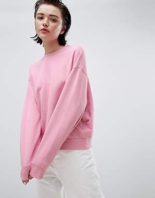 Weekday cropped sweatshirt in pink
