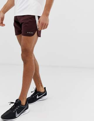 Asos 4505 4505 running shorts with side stripe and curve hem in burgundy and white