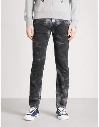 A Bathing Ape Faded slim-fit tapered jeans
