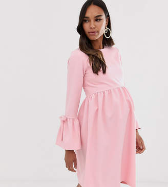 Queen Bee skater dress with fluted sleeve in pink