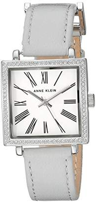 Anne Klein Women's AK/2939SVLG Swarovski Crystal Accented Silver-Tone and Light Grey Leather Strap Watch