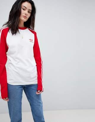 adidas adicolor Three Stripe Raglan Top In Red
