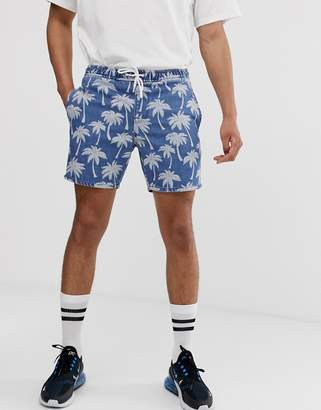 Asos Design DESIGN denim short shorts in mid wash blue palm print with elasticated waist
