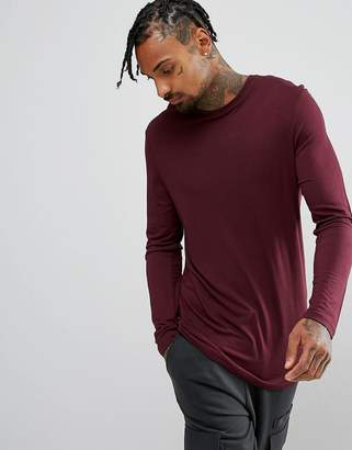 Asos DESIGN longline long sleeve t-shirt in drape viscose fabric in burgundy