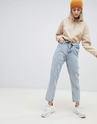 Asos DESIGN Ritson rigid mom jeans with exposed fly detail and fold over waist band in light stone wash