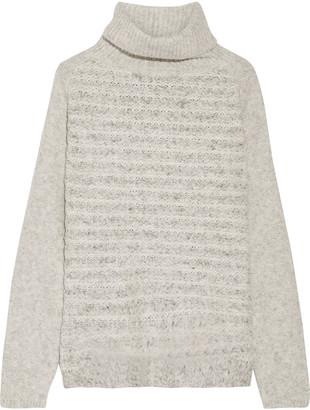Line Vera bouclé-knit turtleneck sweater $198 thestylecure.com