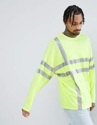 Asos Design DESIGN oversized long sleeve t-shirt in neon yellow with reflective grid print
