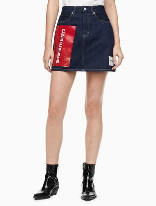 Calvin Klein dark wash high rise logo mini skirt