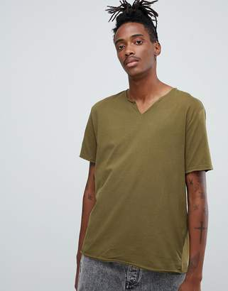 Asos Design DESIGN relaxed fit t-shirt with raw notch neck in green