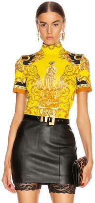 Versace Baroque Turtleneck Crop Top in Caramel & Yellow   FWRD