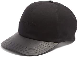 Leather-peak cap