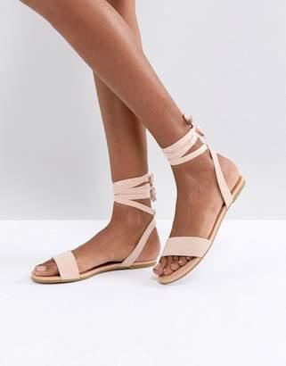 Asos DESIGN FIOLA Tie Leg Flat Sandals
