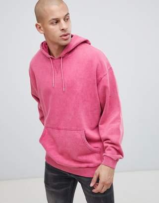 Asos Design DESIGN oversized hoodie with acid wash in pink
