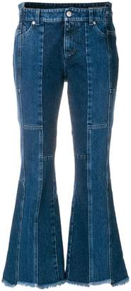 Alexander McQueen asymmetric flared cropped jeans