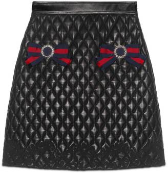 Quilted leather skirt with Web $2,800 thestylecure.com