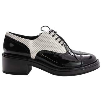Chanel Patent leather lace ups