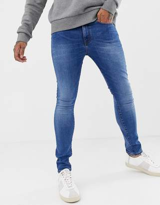New Look skinny jeans in bright blue