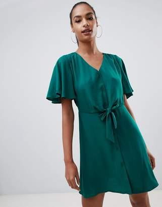 PrettyLittleThing tie waist button through angel sleeve mini dress in emerald