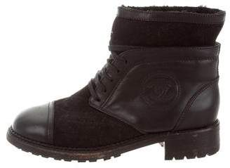 chanel quilted boots quilted leather preowned at therealreal chanel quilted cc ankle boots womens shopstyle