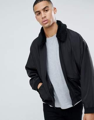 Asos DESIGN oversized bomber jacket in black with fleece collar
