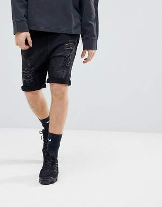 Asos DESIGN Drop Crotch Denim Shorts With Extreme Rips In Washed Black