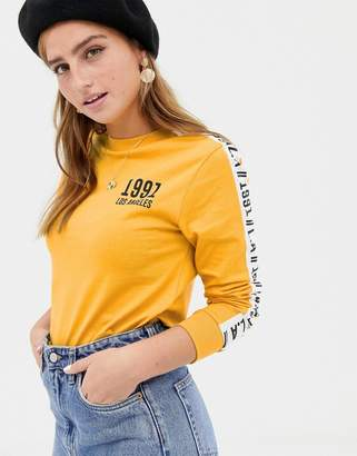 New Look 1991 slogan long sleeve tee in mustard