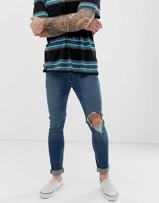 f891dc8983b Asos Design DESIGN recycled super skinny jeans in mid wash blue with open knee  rip