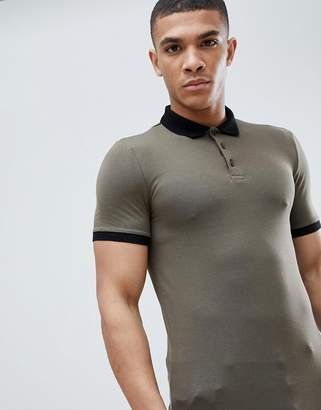 Asos DESIGN muscle fit polo in jersey with contrast collar and curved hem