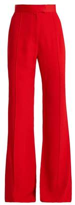 Khaite - Harriet Wide Leg Flared Crepe Trousers - Womens - Red