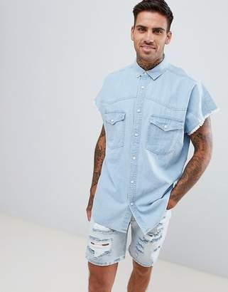 Asos DESIGN oversized raw edge bleach wash denim shirt