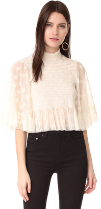McQ - Alexander McQueen Smocked Ruffle Top $490 thestylecure.com