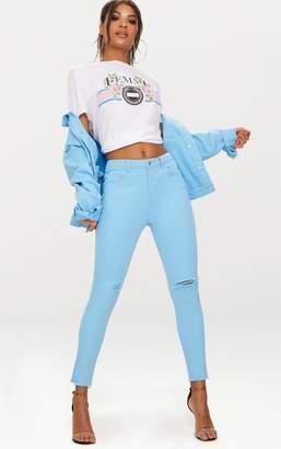 PrettyLittleThing Baby Blue Rip Knee Skinny Jean