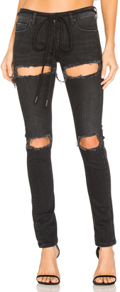 OFF-WHITE Ripped Skinny Jeans $591 thestylecure.com