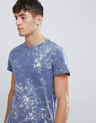 Asos DESIGN t-shirt with roll sleeve and bleach wash