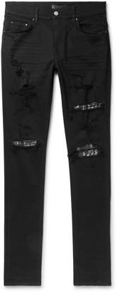Amiri Skinny-Fit Embellished Twill-Panelled Distressed Stretch-Denim Jeans - Men - Black