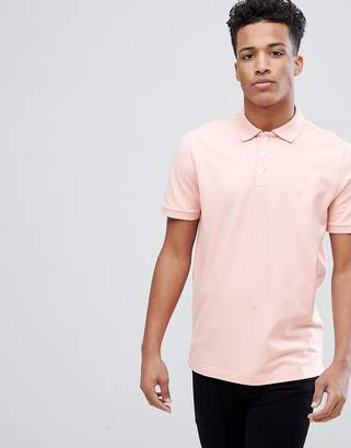 Abercrombie & Fitch Stretch Core Moose Icon Logo Slim Fit Polo in Coral