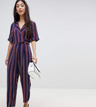 Asos DESIGN Petite wrap jumpsuit with self buckle in stripe