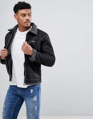 Nicce London faux shearling jacket in black