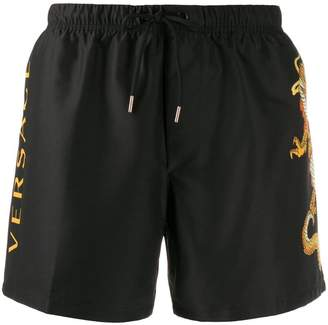 Versace dragon motif swim shorts