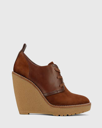 Tablyn Round Toe Lace Up Wedge Booties