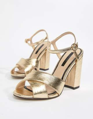 69986b8bf5d9a at ASOS Miss Selfridge cross over heeled sandals in gold