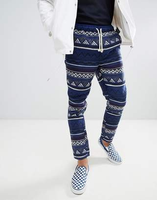 Asos Design DESIGN Festival Tapered Pants In Blue Geo-Tribal Jacquard With Elasticated Waist